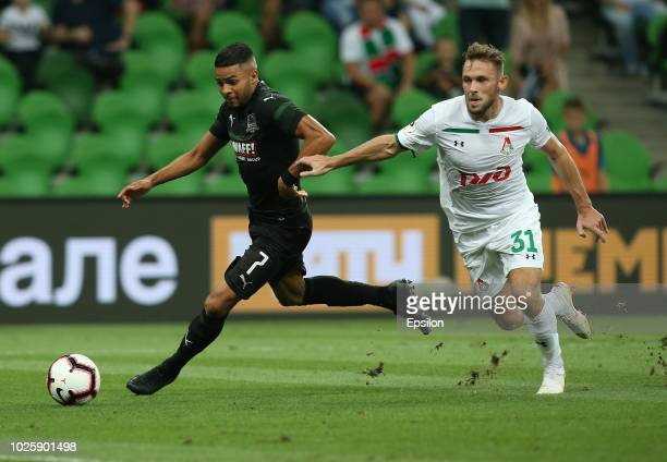 Wanderson of FC Krasnodar vies for the ball with Maciej Rybus of FC Lokomotiv Moscow during the Russian Premier League match between FC Krasnodar v...