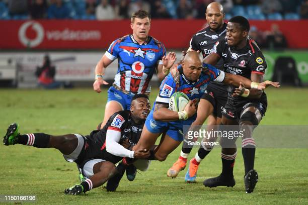 Wandisele Simelane of the Lions tackles Cornal Hendricks of the Bulls during the Super Rugby match between Vodacom Bulls and Emirates Lions at Loftus...
