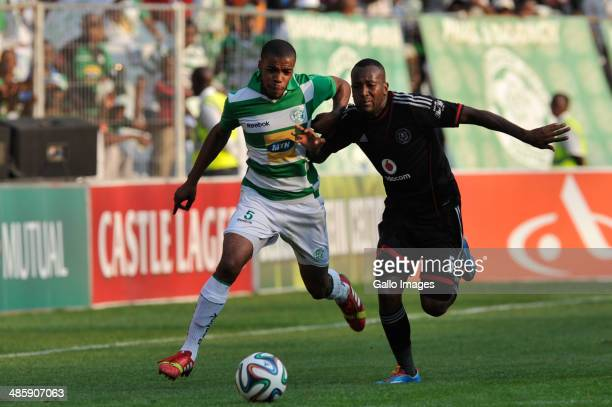 Wandisile Letlabika of Celtics and Mpho Makola of Pirates of Pirates compete during the Absa Premiership match between Bloemfontein Celtic and...