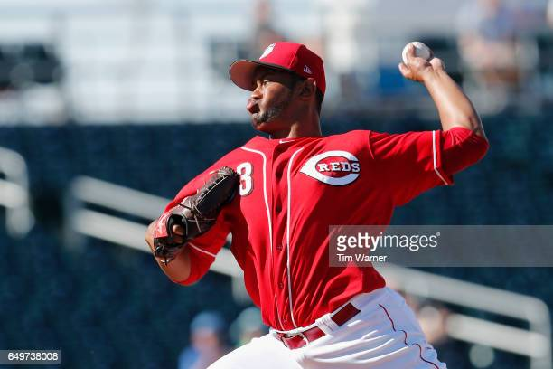 Wandy Peralta of the Cincinnati Reds pitches in the eighth inning against the Los Angeles Angels during the spring training game at Goodyear Ballpark...