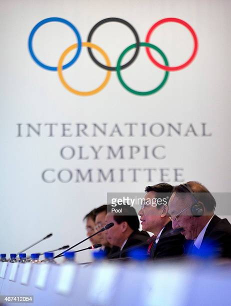 Wang Anshun second from right mayor of Beijing and chairman of the Beijing 2022 Winter Olympics bid committee speaks during a meeting with the 2022...