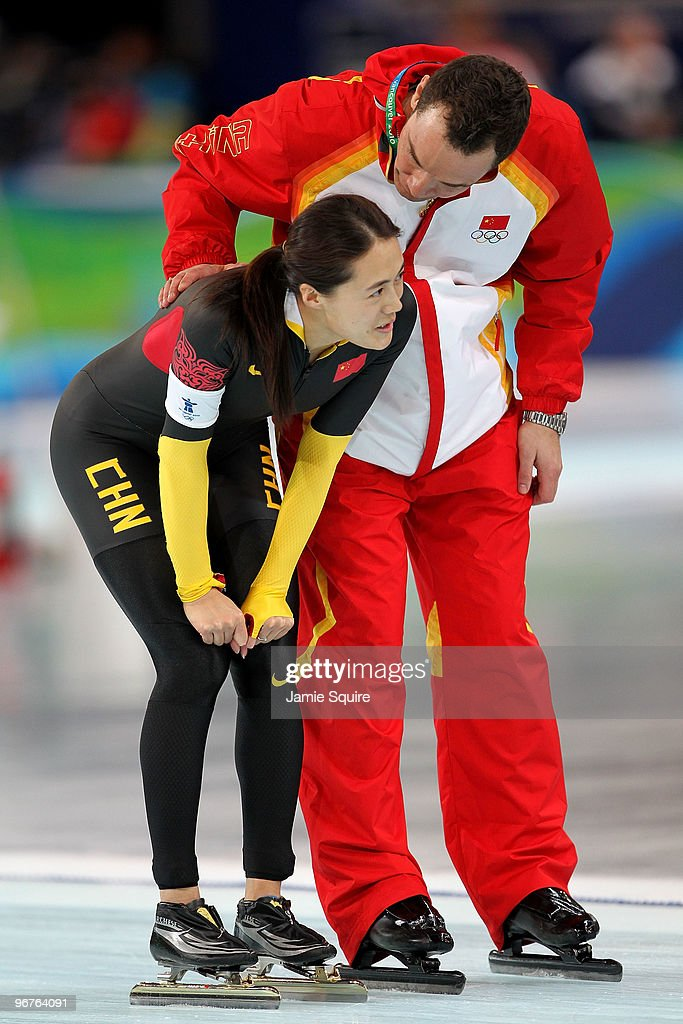 Wang Beixing of China reacts with her coach after winning the bronze during the women's speed skating 500 m on day five of the Vancouver 2010 Winter Olympics at Richmond Olympic Oval on February 16, 2010 in Vancouver, Canada.