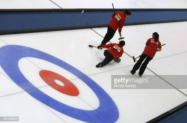 Wang Bingyu of the Chinese women's curling team launches the stone down the ice against Korea at the Asian Winter Games in Changchun in China's...