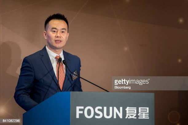 Wang Can chief financial officer of Fosun International Ltd speaks during a news conference in Hong Kong China on Thursday Aug 31 2017 Fosun the...