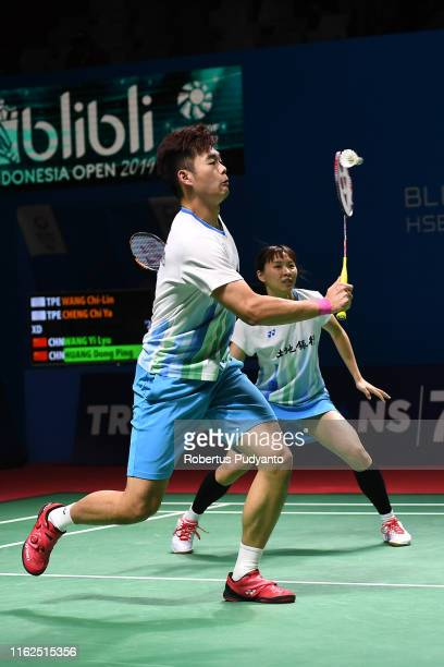 Wang Chi Lin and Cheng Chi Ya of Chinese Taipei compete against Wang Li Yu and Huang Dong Ping of China on day two of the Bli Bli Indonesia Open at...