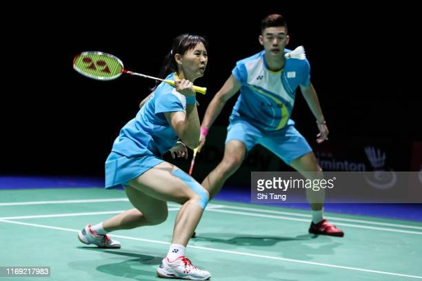 Wang ChiLin and Cheng Chi Ya of Chinese Taipei compete in the Mixed Doubles second round match against Seo Seung Jae and Chae Yujung of Korea during...