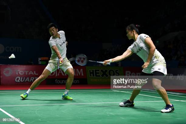 Wang ChiLin and Lee Chia Hsin of Chinese Taipei compete against Riky Widianto and Masita Mahmudin of Indonesia during the Mixed Doubles Round 1 match...