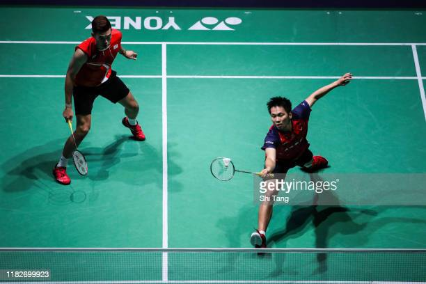 Wang ChiLin and Lee Yang of Chinese Taipei compete in the Men's Doubles first round match against Lee JheHuei and Yang PoHsuan of Chinese Taipei on...