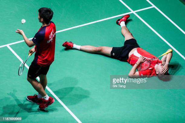Wang ChiLin and Lee Yang of Chinese Taipei react in the Men's Doubles first round match against Lee JheHuei and Yang PoHsuan of Chinese Taipei on day...