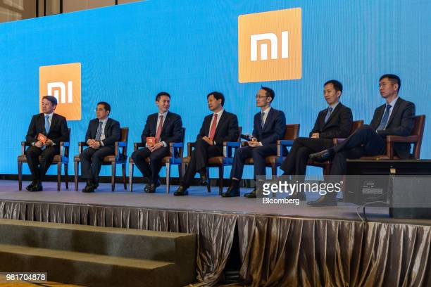 Wang Chuan, co-founder and senior vice president of Xiaomi Corp., left to right, Li Wanqiang, co-founder, Chew Shou Zi, senior vice president and...
