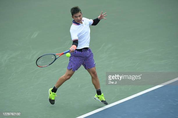 Wang Chukang of China in action during the Men's singles first round against Gao Xin of China on day 2 of the 2020 CTA Tour 800 1000 Finals Chengdu...