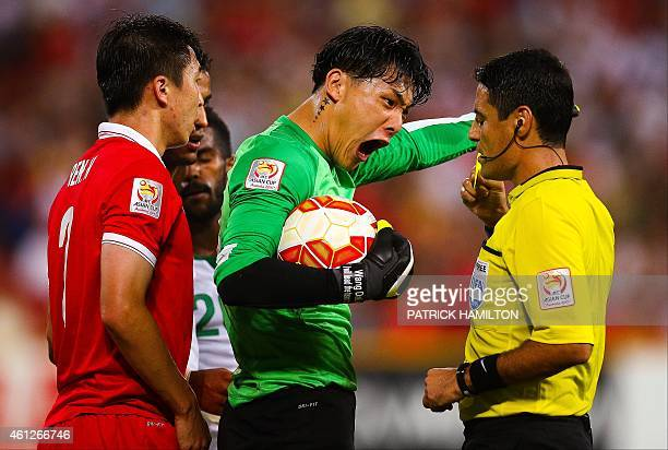 Wang Dalei of China shouts at referee Alireza Faghani of Iran during the first round Asian Cup football match between China and Saudi Arabia at the...
