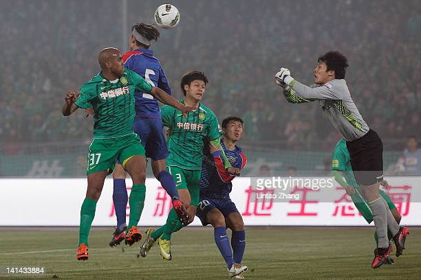 Wang Dalei of Shanghai Shenhua makes a save from Australia International player Da Costa Reinaldo Elias of Beijing Guoan during the Chinese Super...
