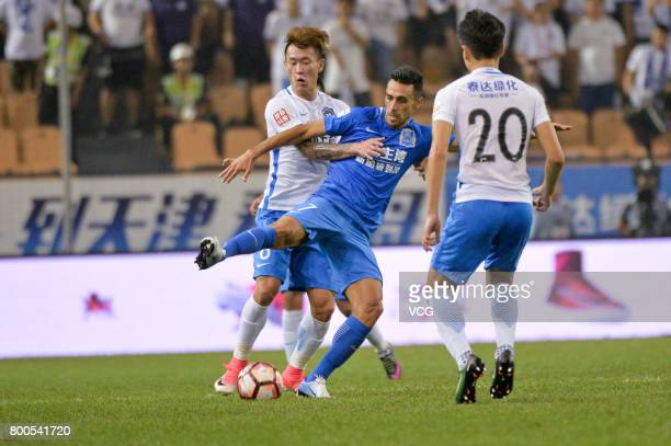 Wang Dong of Tianjin Teda and Eran Zehavi of Guangzhou RF compete for the ball during 2017 Chinese Super League 14th round match between Tianjin Teda...