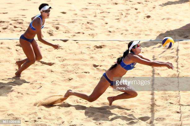 Wang Fan of China in action with Xia Xinyi of China during the match against Valentyna Davidova and Levgeniia Shchypkova of Ukraine on Day 4 of FIVB...