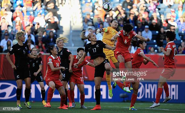 Wang Fei of China punches the ball clear from Hannah Wilkinson of New Zealand during the FIFA Women's World Cup 2015 group A match between China PR...