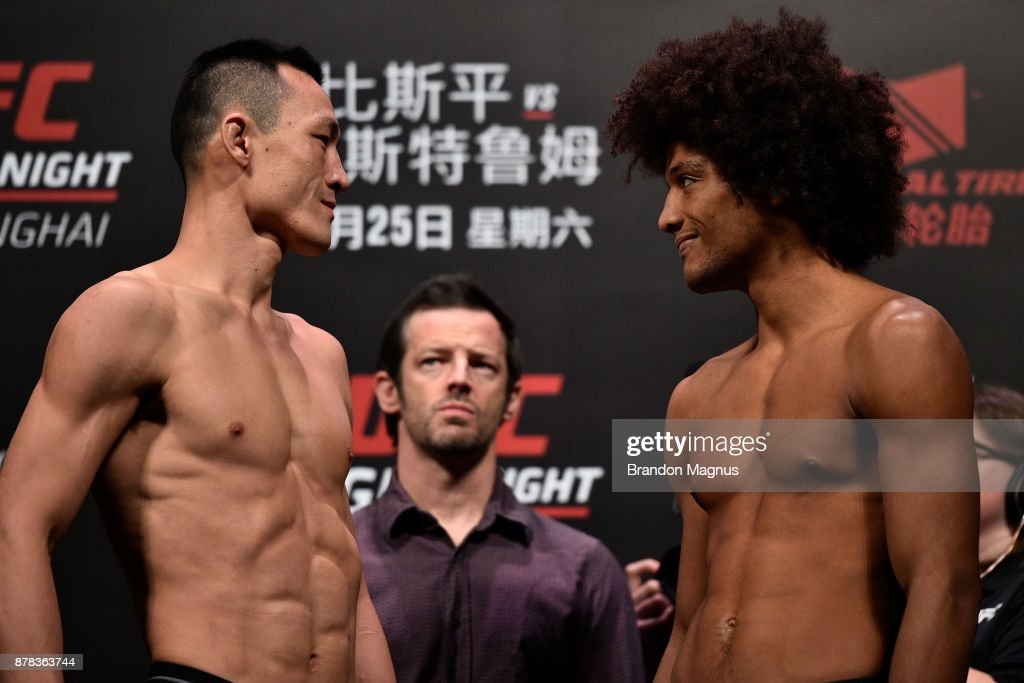 Wang Guan of China and Alex Caceres face off during the UFC Fight Night weigh-in on November 24, 2017 in Shanghai, China.