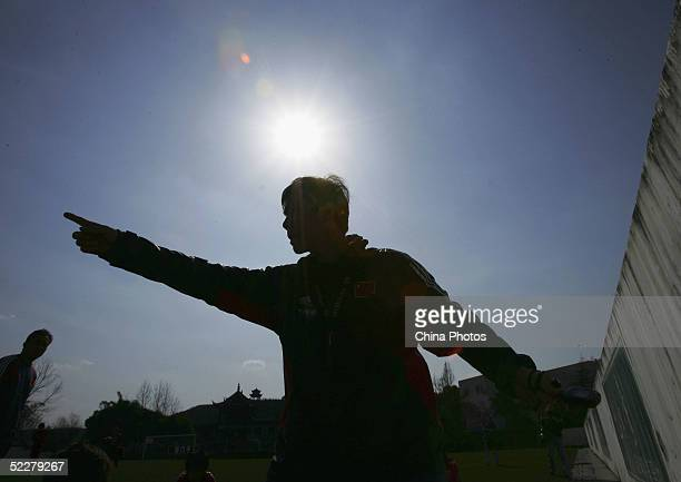 Wang Haiming, coach of the Chinese womens football team, instructs his players in training at a training base on March 4, 2005 in Chengdu of Sichuan...
