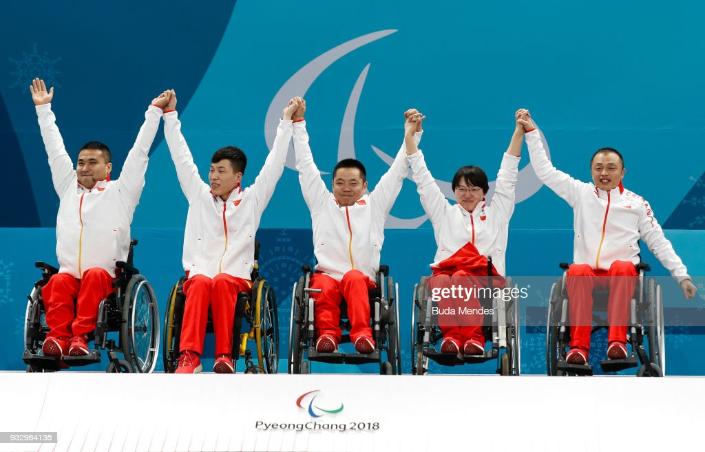 Wang Haitao, Chen Jianxin, Liu Wei, Wang Meng and Zhang Qiang celebrate the golden medal after the Curling Mixed Golden Medal match between China and Norway during day eight of the PyeongChang 2018 Paralympic Games on March 17, 2018 in Gangneung, South Korea.