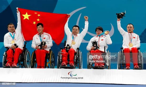 Wang Haitao Chen Jianxin Liu Wei Wang Meng and Zhang Qiang celebrate the golden medal after the Curling Mixed Golden Medal match between China and...