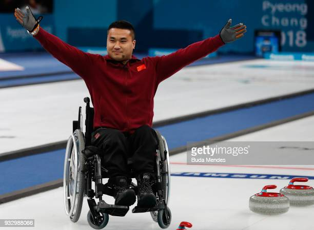 Wang Haitao of China celebrates the golden medal after defeating Norway in the Curling Mixed Golden Medal match between China and Norway during day...