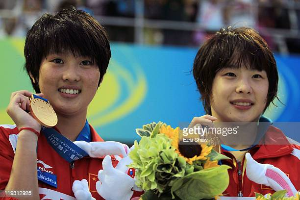 Wang Hao and Chen Ruolin of the People's Republic of China celebrate winning the gold medal after the Women's 10m Platform Synchro Final during Day...