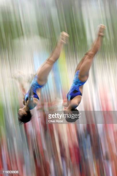 Wang Hao and Chen Ruolin of the People's Republic of China compete in the Women's 10m Platform Synchro Final during Day Three of the 14th FINA World...
