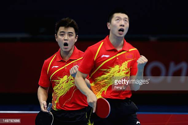 Wang Hao and Ma Long of China celebrate during Men's Team Table Tennis first round match against team of Russia on Day 8 of the London 2012 Olympic...