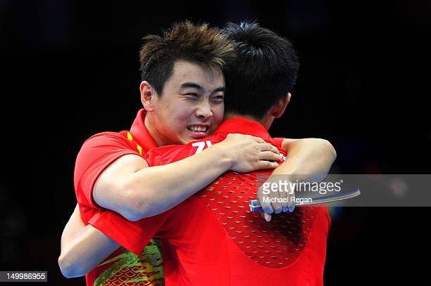 Wang Hao and Zhang Jike of China celebrate defeating Seungmin Ryu and Sang Eun Oh of Korea 3-0 and winning the Men's Team Table Tennis gold medal...