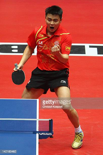 Wang Hao of China celebrates his victory during his match against Ryu Seung Min of South Korea during the LIEBHERR table tennis team world cup 2012...
