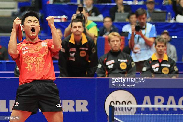 Wang Hao of China celebrates the 3-1 victory and winning the World Cup against Patrick Baum of Germany during the LIEBHERR table tennis team world...