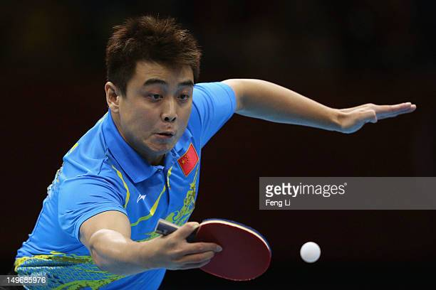Wang Hao of China plays a shot during Men's Singles Table Tennis Gold medal match against Zhang Jike of China on Day 6 of the London 2012 Olympic...