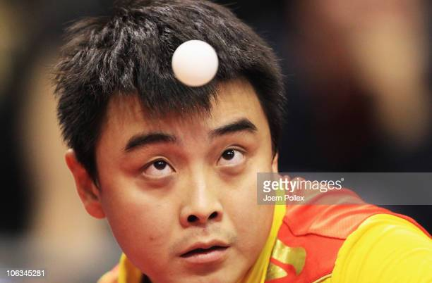 Wang Hao of China serves to Peng Tang of Hong kong during their Table Tennis World Cup 2010 match at the Boerdeland Hall on October 29, 2010 in...
