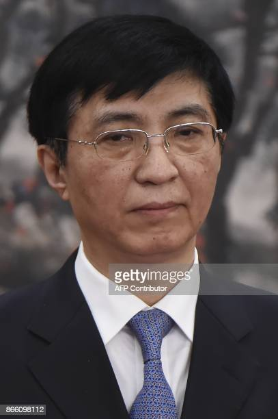Wang Huning a member of the Political Bureau Central Committee stands as he is introduced as a new member of the Communist Party of China's Politburo...