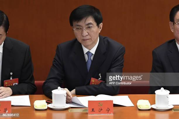 Wang Huning a member of the Political Bureau of the CPC Central Committee attends the opening session of the Chinese Communist Party's fiveyearly...