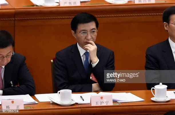 Wang Huning a member of the Standing Committee of the Political Bureau of the Communist Party of China Central Committee attends the opening session...
