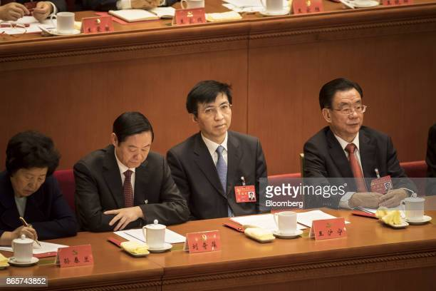 Wang Huning head of the Communist Party of China's Central Policy Research Center second right attends the closing session of the 19th National...