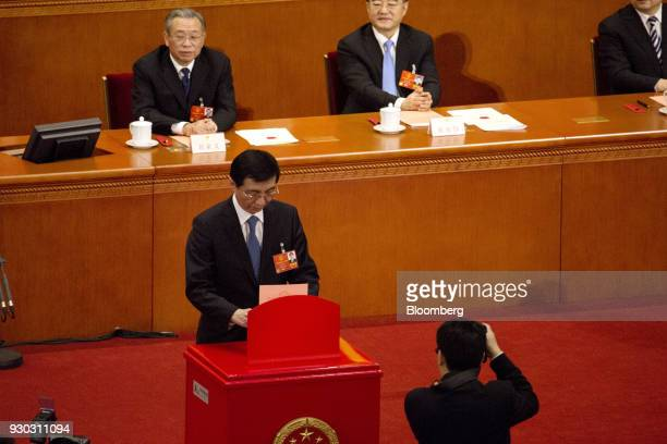 Wang Huning member of the Communist Party of China's Politburo Standing Committee casts his ballot during a vote to repeal presidential term limits...
