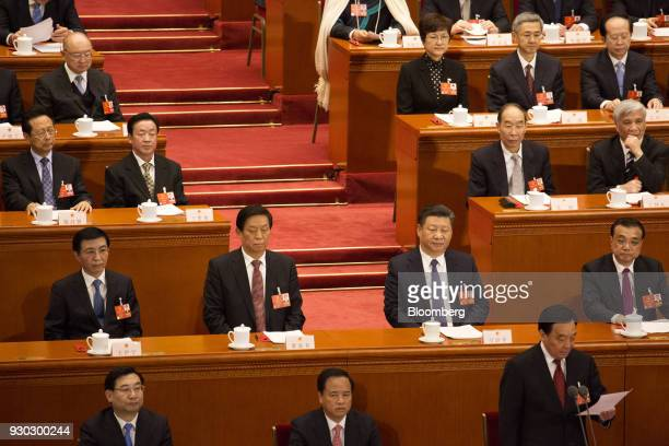 Wang Huning member of the Communist Party of China's Politburo Standing Committee second row from left Li Zhanshu member of the Communist Party of...