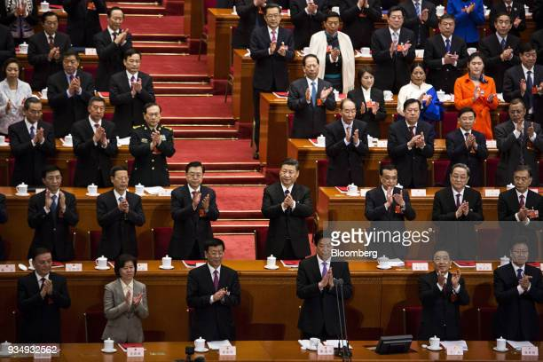 Wang Huning member of the Communist Party of China's Politburo Standing Committee second row from left to right Zhang Gaoli China's former vice...