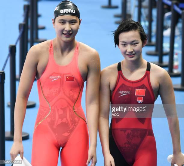 Wang Jianjiahe and Li Bingjie of China react in the Women's 400m Freestyle Final on day 4 of the 14th FINA World Swimming Championships at Hangzhou...