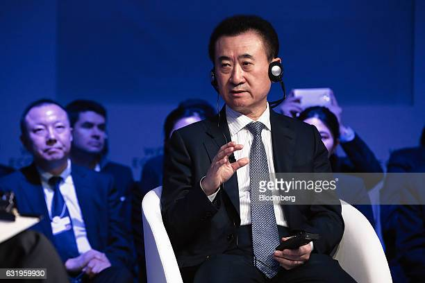 Wang Jianlin, billionaire and chairman and president of Dalian Wanda Group Co., gestures as he speaks during a panel session at the World Economic...