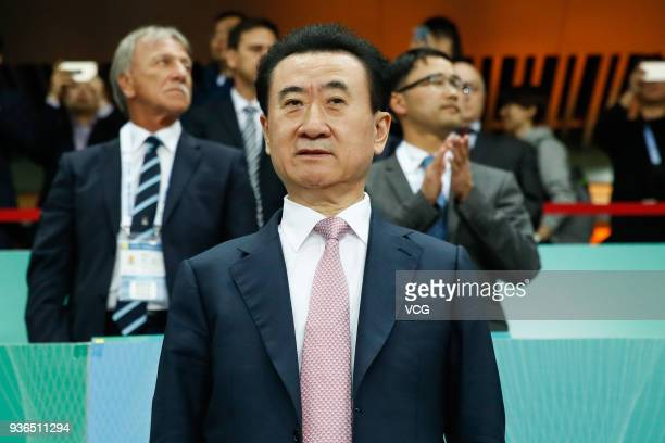 Wang Jianlin, Chairman and President of Dalian Wanda Group Co., watches from the stand during the 2018 China Cup International Football Championship...