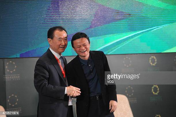 Wang Jianlin , Chairman of the Dalian Wanda Group, shakes hands with Jack Ma, Executive Chairman of Alibaba Group during the 2015 China Green...