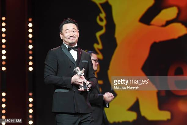 Wang Jingchun winner of the Silver Bear for Best Actor for 'So long My Son' is s on stage at the closing ceremony of the 69th Berlinale International...