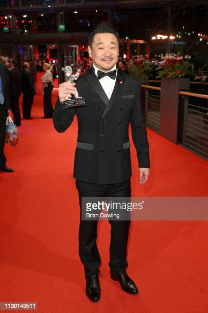 Wang Jingchun winner of the Silver Bear for Best Actor for 'So long My Son' poses after the closing ceremony of the 69th Berlinale International Film...