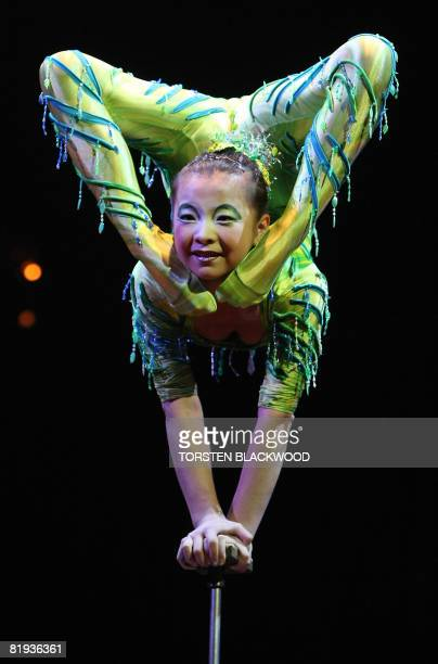 Wang Junru of China performs hand balancing during the final dress rehearsal of Cirque du Soleil's 'Dralion' in Sydney on July 15 2008 The show which...