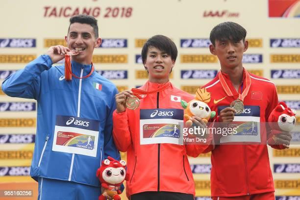 Wang Kaihua of China Koki Ikeda of Japan and Massimo Stano of Italy pose for photo during medal ceremony of Men's 20 kilometres Race Walk of IAAF...