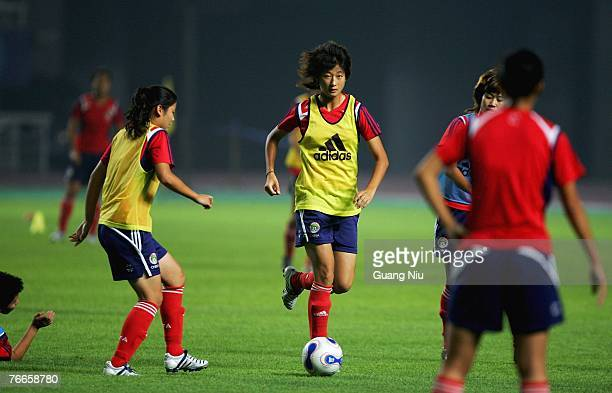 Wang Kun of China and her teammates attend a training session for the FIFA 2007 World Cup in China at Wuhan Sports Center Stadium on September 11,...