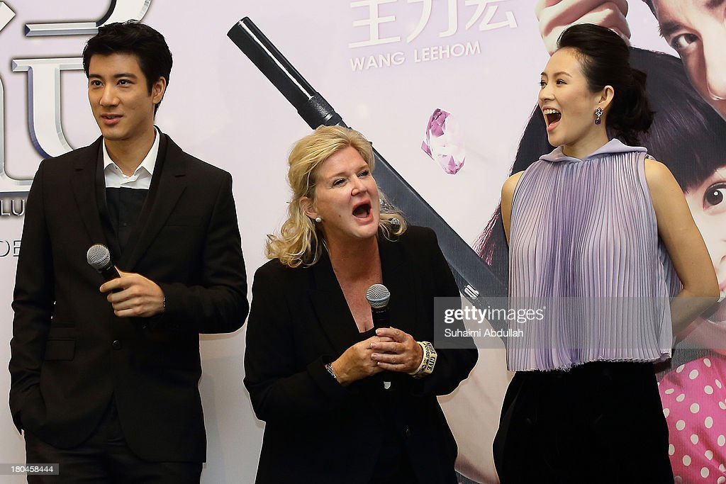 Wang Lee Hom, Dennie Gordon and Zhang Ziyi react on stage during the media conference of the movie premiere of 'My Lucky Star' at the ArtScience Museum at Marina Bay Sands on September 13, 2013 in Singapore.